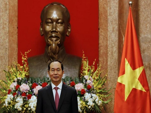 Vietnam's President Tran Dai Quang waits for arrival of Russia's Defence Minister Sergei Shoigu in Hanoi