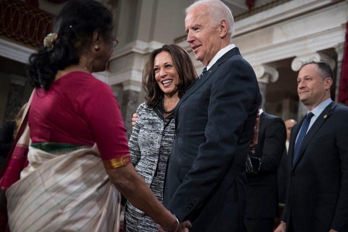 Joe- Biden shake hands with Indian woman