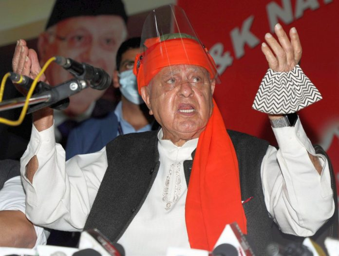 National Conference President Farooq Abdullah addresses party workers at the C (PTI)