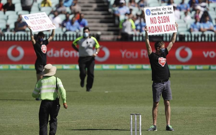 protestors in India Australia match against Adani group