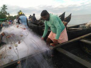 Alocious, near boats, Pallikakdav Nayarambalam