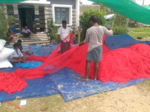 Fishermen making net