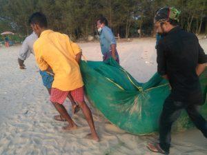 Fishermen carrying net