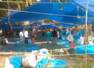 Fishermen in net making, Elankunnappuzha