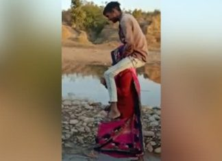 woman forced to carry husband's relative on shoulders in Madhya Pradesh