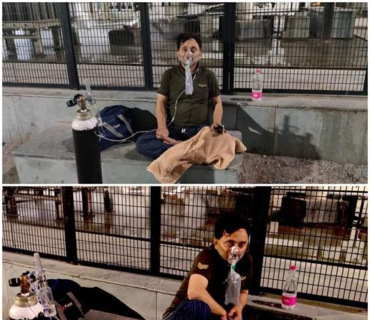 Patient arranged his own Oxygen Cylinder and sitting outside Lok Nayak Hospital